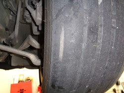 Left side tire wear on BMW due to worn control arm bushings