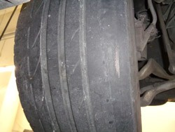 Right side tire wear on BMW due to worn control arm bushings